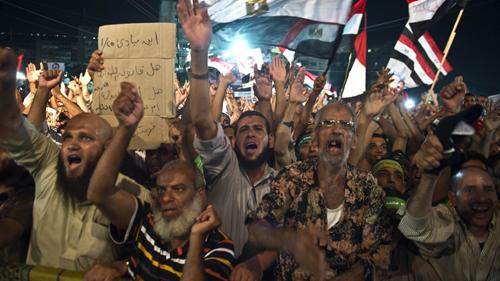 Các thành viên tổ chức anh em Hồi giáo và những người ủng hộ ông Morsi. Ảnh:  AFP -TTXVN