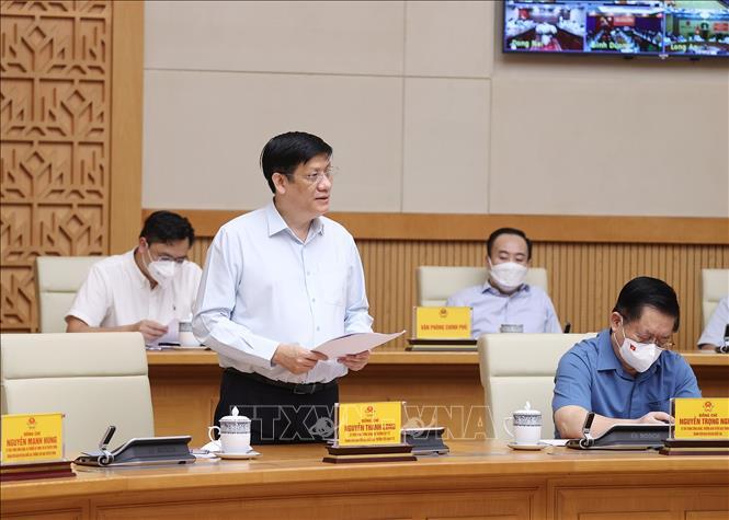 Bộ trưởng Bộ Y tế Nguyễn Thanh Long báo cáo tình hình dịch COVID-19.