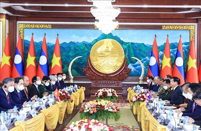 Chủ tịch nước Cộng hòa Xã hội chủ nghĩa Việt Nam Nguyễn Xuân Phúc hội đàm với Tổng Bí thư, Chủ tịch nước Lào Thongloun Sisoulith. Ảnh: Thống Nhất/TTXVN
