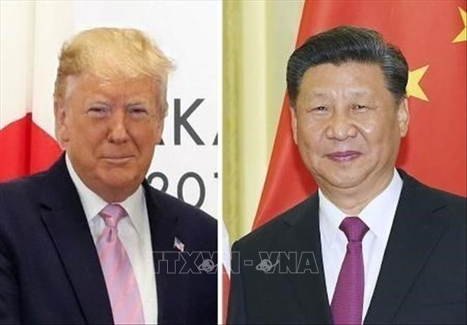 Tổng thống Mỹ Donald Trump (ảnh trái) và Chủ tịch Trung Quốc Tập Cận Bình. Ảnh tư liệu: Kyodo/TTXVN